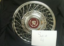 """SET OF 4 - NEW!!!! NOS GM CADILLAC 14"""" WIRE WHEEL HUBCAPS WITH CENTER CAPS FWD"""