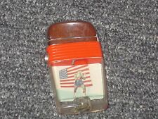 """1960s Scripto """"Buster Mathis"""" lighter (NM) with Mathis/flag image"""