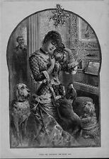 PUG DOG IS THE LUCKY ONE UNDER THE MISTLETOE WOMAN HOLDING THE THE LUCKY DOG