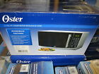 Oster OGB61101 1.1-Cubic-Feet Microwave Oven, Stainless Steel