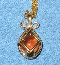 JOAN RIVERS Gold Tone Caged Egg Pendant 24 inch Necklace with Amber Stone
