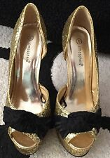 Beautiful gold and black women's shoes