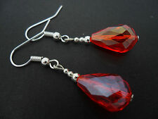 A PAIR OF SHORT RED GLASS   CRYSTAL TEARDROP EARRINGS. NEW.