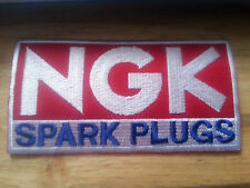 MOTOR RACING RALLY NASCAR SEW/IRON ON PATCH:- N.G.K. SPARK PLUGS RED & BLUE (b)