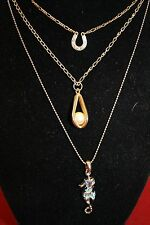 Three necklaces, horse shoe, sea horse and pearl