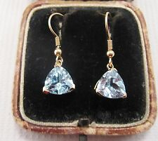 A Pretty Pair of Blue Topaz Earrings set in 9ct Yellow Gold