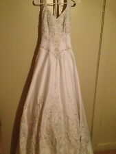 Wedding dress. Size 6. White. A-line halter. Lots of beading. Make me an offer.