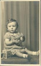 Epsom. Young girl with toys by 'H Parker' East Street.   QR1197