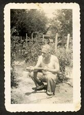 C. 1940 Gent Enjoying a Smoke and Spraying the Tomato Plants with Pesticides