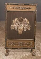 Carved fire screen with a needlework panel with basket of flowers on c... Lot 24