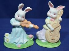 2 bunnies playing instruments figurines