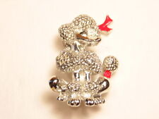 French poodle fashion pin: red bow highlighting silver colored dog