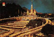 France Lourdes The Basilica illuminated and the torchlight procession Basilique