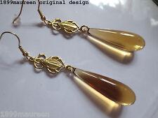 Egyptian Revival Art Deco earrings 1920s Art Nouveau amber lucite vintage drop