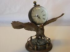 COLD PAINTED BRONZE EAGLE MOUNTED WITH GLASS BALL CLOCK