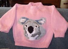 KOALA ... SIZE 1.. NEW HANDKNITTED BUTTON OPENING BACK