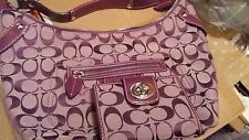 Purple coach purse and wallet