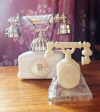 Two Vintage Avon perfume bottle Large and small telephone both empty collectable