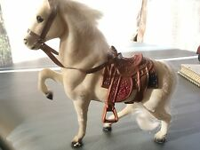 Fuzzy white prancing horse with saddle