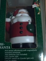 FESTIVE LIGHT UP LED CANDLE WAVE MOTION SANTA CLAUS FATHER CHRISTMAS DECORATION