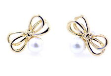 Super Cute gold tone bow and pearl stud earrings