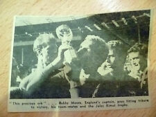 1966 World Cup Press Cutting- Bobby Moore, England's Captain Pays Fitting.......