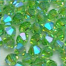 X 100 Cristalli SWAROVSKI ELEMENTS ORIGINALI 4mm BICONE BICONO BEAD PERIDOT