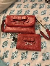 Guess clutch wristlet set