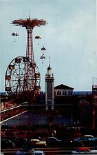 CONEY ISLAND NY VIEW OF SWIMMING POOL PARACHUTE JUMP AND FERRIS WHEEL