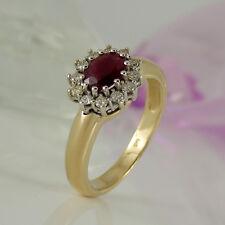 Ring in 585/- Gelb/Weißgold mit 1 Rubin ca 0,50 ct + 12 Diamanten ca 0,20 ct