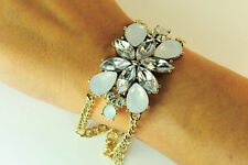 LADIES CHUNKY GOLD FLORAL WHITE STONE BRACELET STATEMENT PIECE BRAND NEW (CL10)