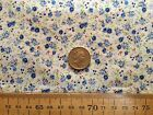 FLORAL POLYCOTTON FABRIC SMALL MEADOW MIX - CREAM BACKGROUND WITH BLUE PETAL