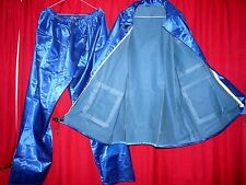 shiny blue satin rubber lined raincoat jacket trousers fetish slocky rustle TV