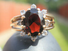 9CT GOLD LARGE GARNET AND DIAMOND RING