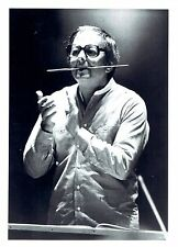 1984 Vintage Photo conductor & pianist Andre Previn with baton in his mouth
