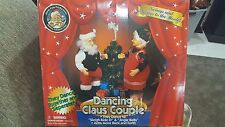 Christmas Dancing Claus Couple Gemmy Plays music Motion/dance