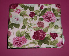 Fabric fat quarter with pink,red and white roses with green leaves on pink