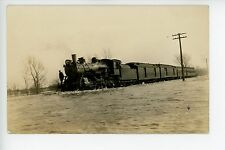 Train Plowing through a Flood RPPC Interesting Railroad Photo 1910s