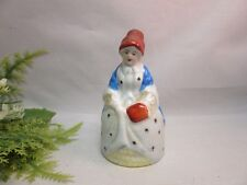 Vtg hand painted ceramic Japan figural bell. Lady in dress