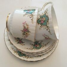 Royal Stafford porcelain, two cups, three tea saucers and three plates.