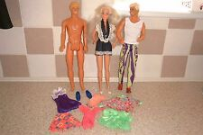 VINTAGE BARBIE AND TWO KEN DOLLS PLUS OUTFITS AND SHOES