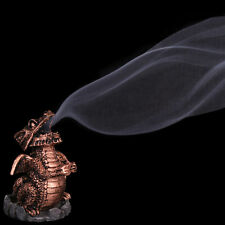 Copper smoking dragon incense cone holder.