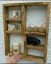 Rustic Hanging wooden wall frame shelving.