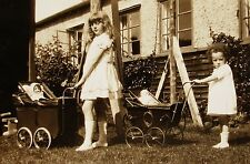 SMALL VINTAGE PHOTO OF 2 CUTE GIRLS PUSHING THEIR LOVELY DOLLS IN DOLL BUGGIES