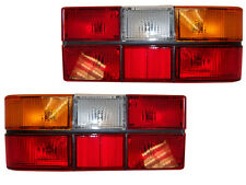 VOLVO 240 244 tail light pair+black center molding.new 1372450 1372449