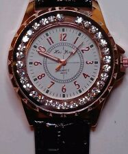 UNISEX WRIST WATCH-CASE IS GOLD TONE WITH RHINESTONES-NEW-NEVER WORN OR USED.