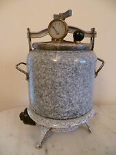 AN ANTIQUE, GREY FLECK ENAMEL PRESSURE COOKER AND RING FROM FRANCE 'CUITOUVITT'