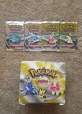Four Neo Genesis Pokemon Booster Packs. Factory Sealed MINT + Booster Box