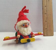 "VINTAGE 3 1/2"" Wooden Elf in Airplane CHRISTMAS ORNAMENT"