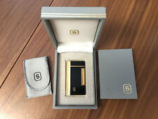 H. STERN LIGHTER Black Lacquer and Gold Trim